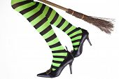 foto of wiccan  - Green and black striped legs of a witch flying on her broomstick - JPG