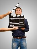 Director Clapping The Clapper Board On Grey Background poster