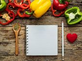 Flat Lay Of Blank Recipe Cooking Book And Utensils With Herbs And Colorful Bell Pepper Over Wooden B poster