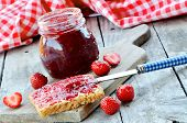 Jar Of Strawberry Jam, Fresh Strawberries And Toast Bread With Butter And Jam On Wooden Table. Red C poster