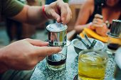 Tourists Drink Vietnamese Coffee Filter Cold Coffee Cup With A Bow Of Ice And Coffee Filter Marker O poster