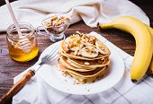 Pancakes With Banana, Walnuts And Honey poster