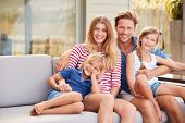 Portrait Of Family Relaxing On Deck At Home poster