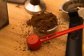 Coffee Tamper With Coffee In Filter Basket And Filter Holder On A Wooden Board For Coffee Scrub poster