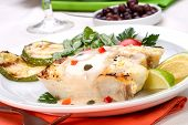 pic of halibut  - Grilled halibut with capers and pepper sauce served with grilled zucchini lemon lime tomatoes - JPG