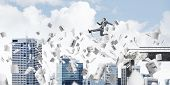 Businessman Jumping Over Gap With Flying Paper Documents In Concrete Bridge As Symbol Of Overcoming  poster