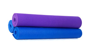 pic of yoga mat  - three rolled yoga exercise mats against white - JPG