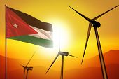 Jordan Wind Energy, Alternative Energy Environment Concept With Turbines And Flag On Sunset - Altern poster