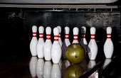 pic of bowling ball  - Pins and a ball at a bowling alley.