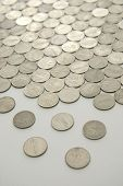 stock photo of splayed  - floor of coins breaking up to individuals  - JPG