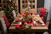 Beautiful table setting with Christmas decorations in living room. Xmas Decoration.  poster