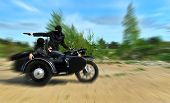 image of sidecar  - Two armed men riding a motorcycle with a sidecar - JPG