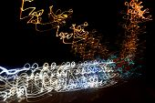 Abstract Curled Thin Long White Anf Orange Road Lights. Long Exposure Abstraction Of Lightning On Bl poster