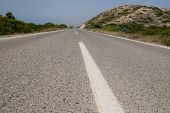 Close Up Of Dividing Line On Asphalt Road At Summer.white Lines On Empty Highway Road With Hills, Mo poster