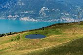 Lake Garda And Green Pastures In Italian Alps, View From The Monte Baldo. Lombardy And Veneto Region poster