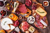 Charcuterie Boards Of Assorted Cheeses, Meats And Appetizers. Above View Table Scene On A Rustic Woo poster