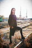 Fashion Shot: Portrait Of The Pretty Rock Girl (informal Model) In Tunic And Leather Pants Standing  poster