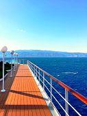 Luxury Cruise Ship Deck. Large Cruise Liner Ship Sailing Across Mediterranean Sea. Wooden Cruise Boa poster