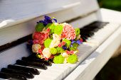 Wedding Bridal Bouquet Pink Purple Flowers Blue Iris On White Piano. Delicate Pink Purple White Gent poster