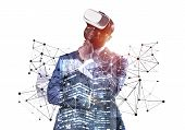 African Businessman Wearing Vr Headset Working With Virtual System. New Reality Modeling And Design. poster