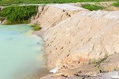 stock photo of landslide  - Baltic coast with eroded beach and landslide after The heavens opened - JPG