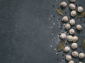 Pattern Of Frozen Uncooked Russian Pelmeni With Peppercorns And Bay Leaves On Black Background. Crea poster