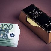 Euro Cash And Gold Bar On A Brown Background. Banknotes. Money. Bill. Ingot. Bullion. poster