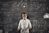 Student Explaining Math Formulas In Classroom , In Front Of The Blackboard Full Of Math Formulas. poster