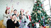 Asian People Party Celebrate Christmas And New Year Eve In House And Christmas Tree Decorate With Co poster