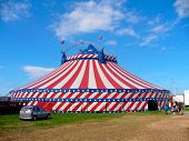 picture of circus tent  - Circus big top tent in field decorated with stars and stripes - JPG