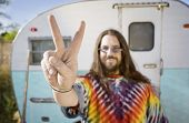pic of peace-sign  - Friendly Hippie with Long Hair in Front of His Trailer making a peace Sign - JPG