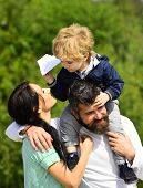 Happy Family - Mother, Father And Son On Sky Background In Summer. Happy Family - Child Son Playing  poster