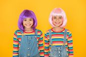 Modern Fashion Is Created To Enjoy. Happy Girls Wear Fashion Hair Wigs Yellow Background. Little Chi poster