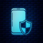 Glowing Neon Smartphone, Mobile Phone With Security Shield Icon Isolated On Brick Wall Background. S poster