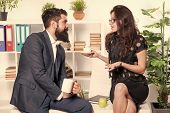 Discussion Over A Cup Of Tea. Professional Couple Participating In Business Discussion During Workin poster