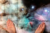 Child Hands Pointing At The Universe In Book Pages poster
