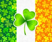 pic of triskele  - Vector Irish flag background made from green and orange clovers with big clover on it - JPG