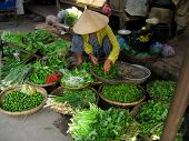 Market Lady Selling Herbs And Vegetables