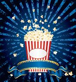 vector illustration of the popcorn explosion on blue grunge burst with blank cinema banner
