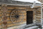 Wooden wagon wheel hanging on the wall