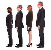 Businesspeople's Eyes Covered With Ribbon