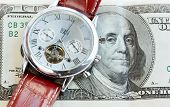 picture of paycheck  - American money and wristwatch with strap - JPG