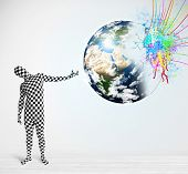 Funny man in body suit looking at colorful splatter 3d earth, Elements of this image furnished by NA