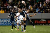 CARSON, CA - APRIL 12: Los Angeles Galaxy defender Omar Gonzalez #4 & Vancouver Whitecaps M Kenny Mi