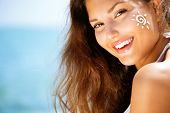 pic of sun-tanned  - Suntan Lotion Woman Applying Sunscreen Solar Cream - JPG