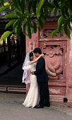 Young Vietnamese couple pose for wedding photos
