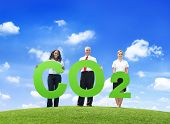 Business People Holding Carbon Dioxide Outdoors