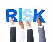 Multiethnic Business People Holding the Word Risk