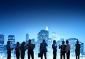 Group Of Business People Working Outdoors With Cityscape As A Background View