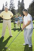 stock photo of foursome  - Senior Asian woman playing golf - JPG